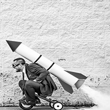 Man on trike with rocket on his back